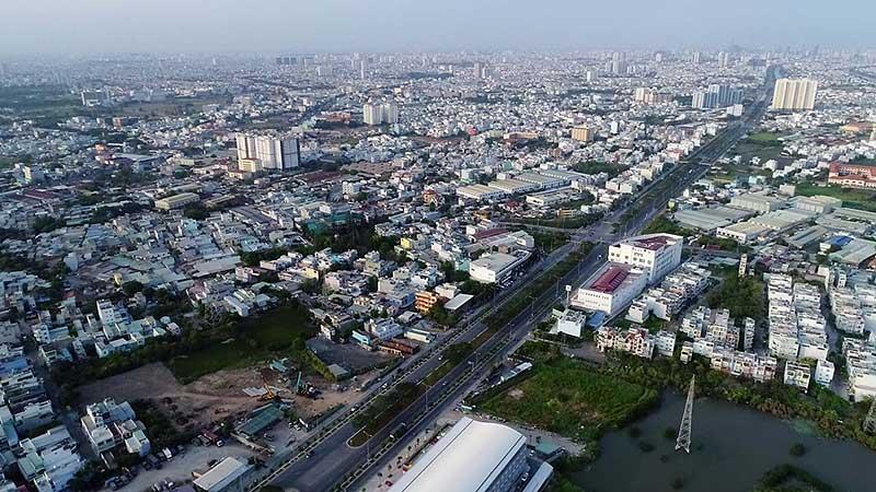 Dai lo Dong Tay Vo Van Kiet voi 16 lan xe noi lien Khu Dong va Tay Sai Gon